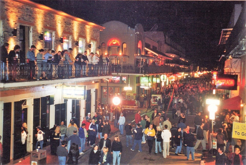 Bourbon street at night with hundreds of people on the street