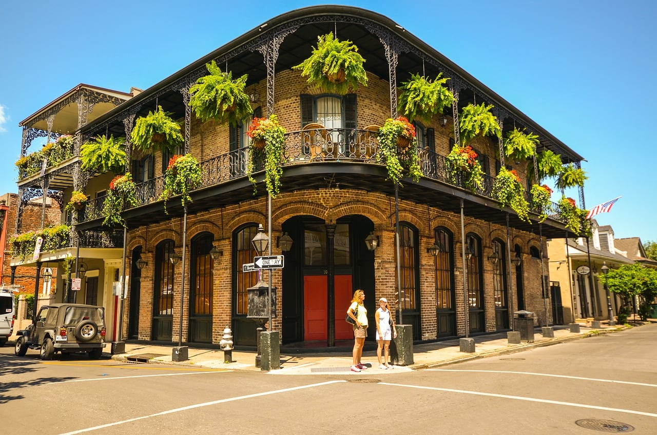 historic building with green hanging baskets